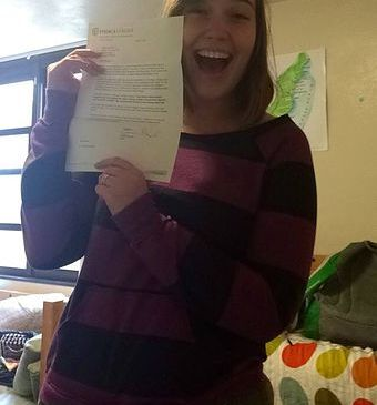 In this photo, I hold up the change of major form that the department chair signed, allowing me to pursue my real passion.