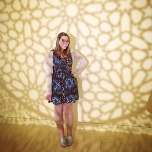 In this photo, I'm in the art museum in Salem, Massachusetts with a kaleidoscope-like light design surrounding me.